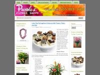 peoplesflowershops.wordpress.com